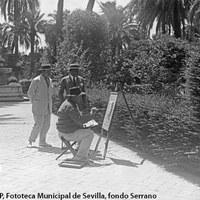 El príncipe abisinio Shervoingthon, acompañado por el artista Juan Lafita, observando a un pintor en los jardines del Real Alcázar. 1924 ©ICAS-SAHP, Fototeca Municipal de Sevilla, fondo Serrano