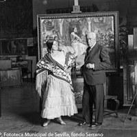 4.- Gonzalo Bilbao posa en su estudio junto a Reyes, su modelo para cuadros de escenas costumbristas. 1932. ©ICAS-SAHP, Fototeca Municipal de Sevilla, fondo Serrano